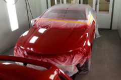 Red Car in Paint Booth